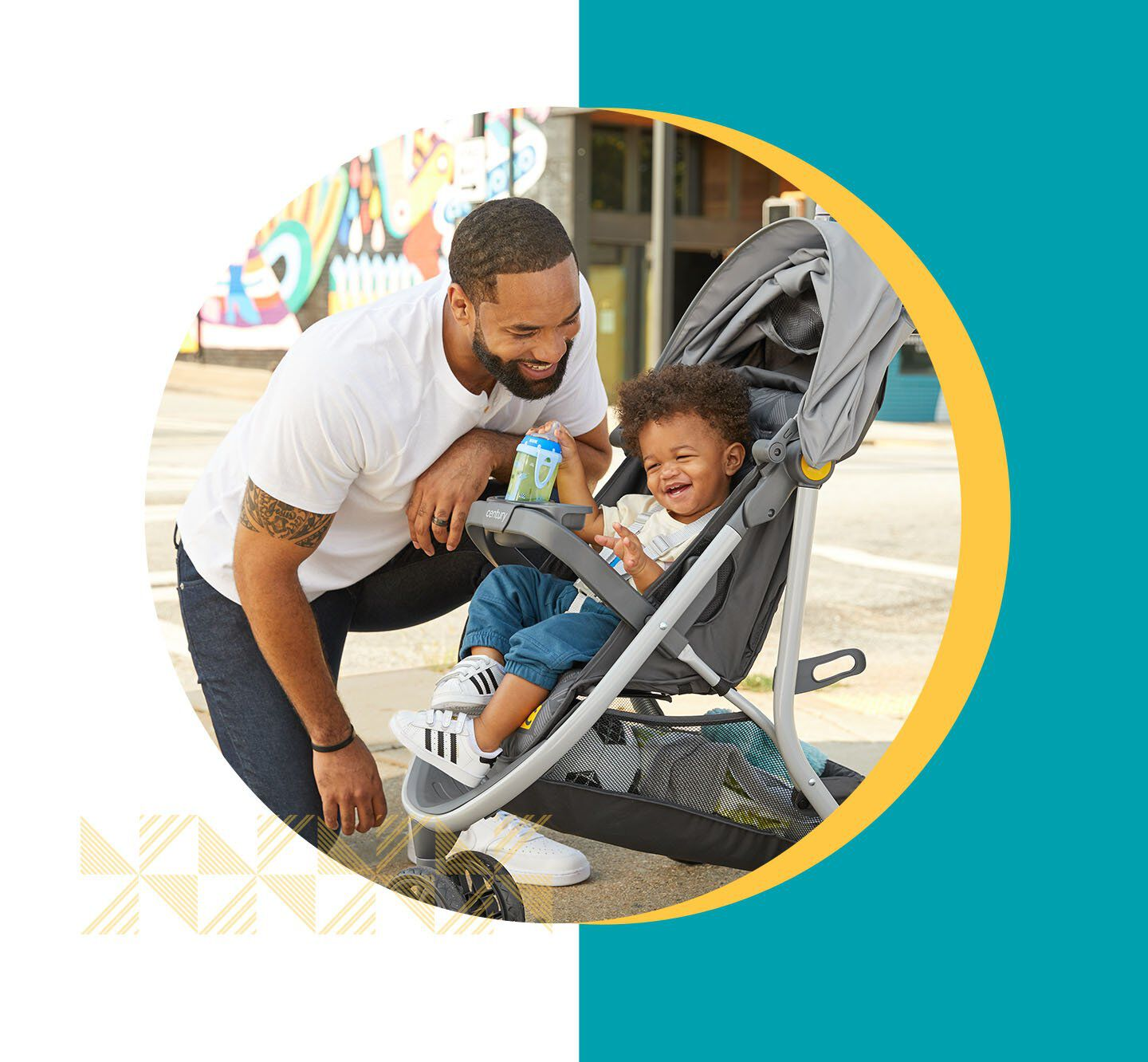 father laughing with child inside stroller